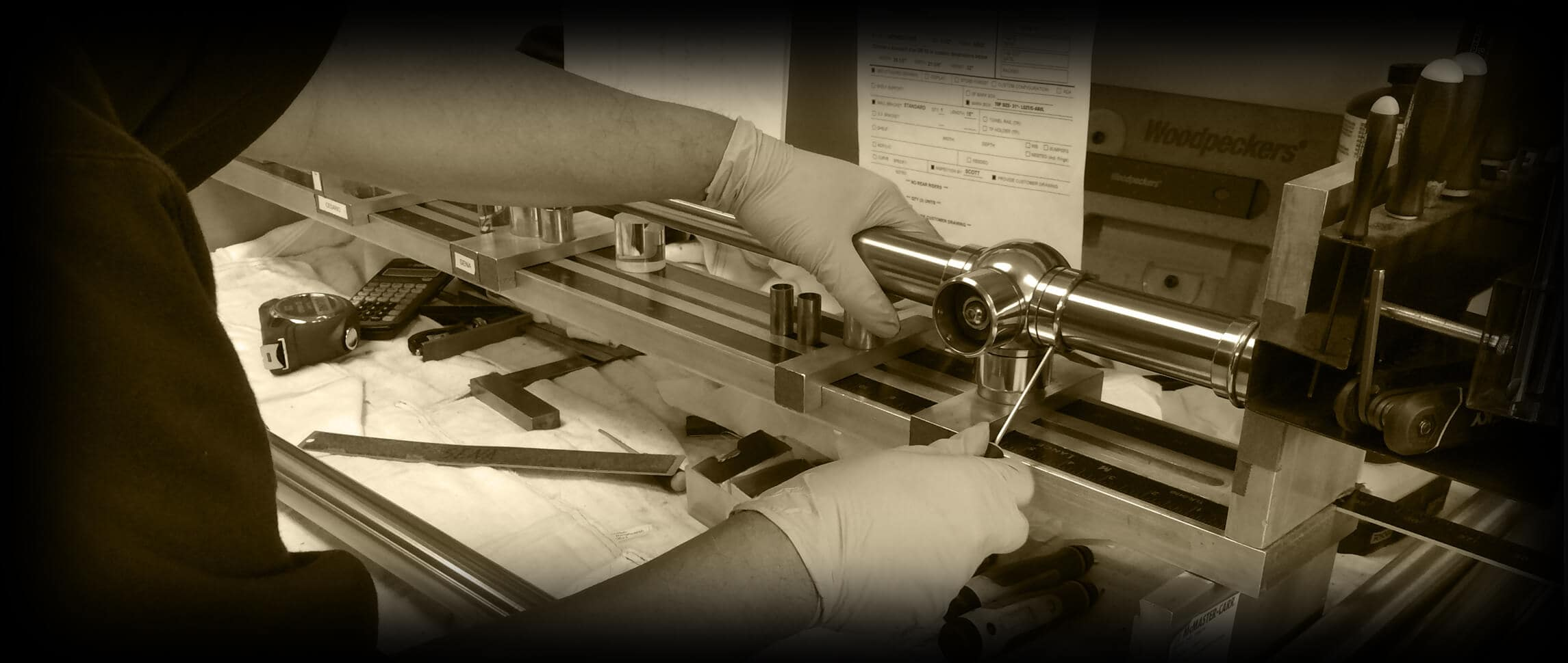 Chrome sink legs being assembled in a precision alignment jig