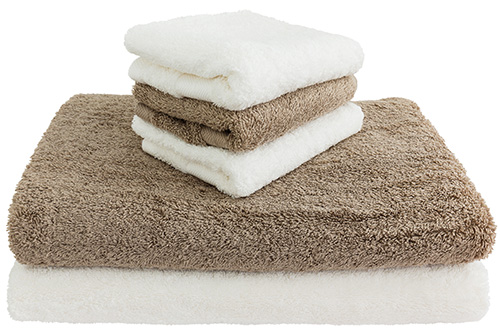 White an brown bath towels. Isolated